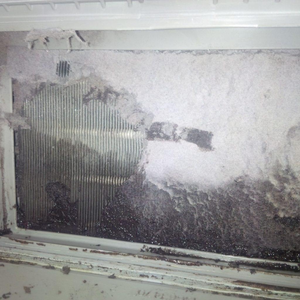 Jak vyčistit ucpaný výměník sušičky prádla pomocí vysavače